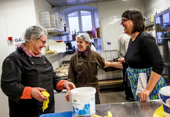 Ladies laughing in kitchen